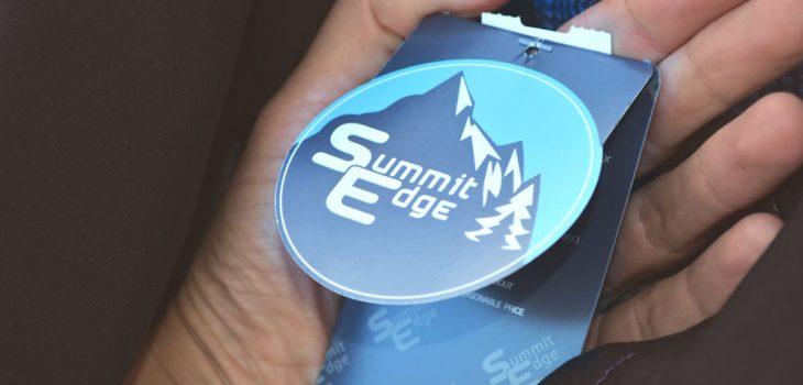 summit edge brand, hang tag, blue, mountains, tree, snow logo, white hand